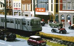 Kleine Grafik zum Thema Modelleisenbahn mit einer Bahn in Spur H0