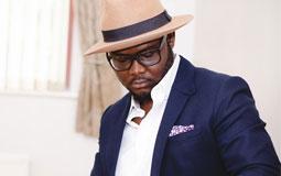 Kleine Grafik zum Thema Herrenmode mit einem stylischen Mann in Anzug und mit Hut