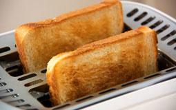 Kleine Grafik zum Thema Toaster mit zwei Toastscheiben aus Toaster schauend