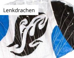 Kleine Grafik zum Thema Herbst mit einem schwarz-grau-blauen Lenkdrachen