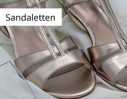 Kleine Grafik zum Thema Schuhe mit silbernen Sandaletten
