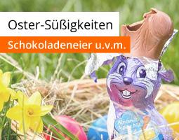 Kleine Grafik zum Thema Ostern mit einem angebissenen Schoko-Osterhasen in einem Osternest