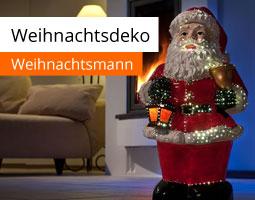Kleine Grafik zum Thema Weihnachtsdeko mit einem LED-Weihnachtsmann, der im abgedunkelten Raum steht