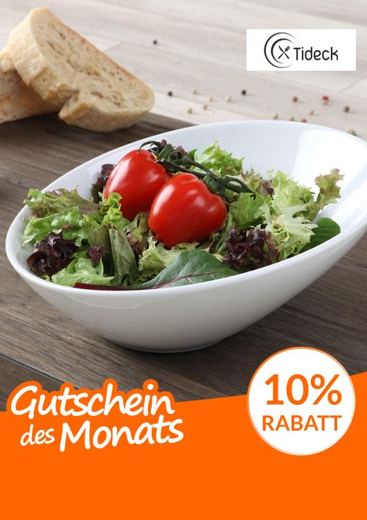 Vibes-Kachel zum Thema Gutschein mit einer weißen Schale der Marke Holst gefüllt mit Salat und zwei Tomaten